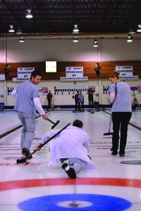 Fred and Marianna Greenhough and Kevin (throwing) as well as team mate Jolene Tym won the A final at the Jasper mixed curling bonspiel April 2. C. Gilbert photo.
