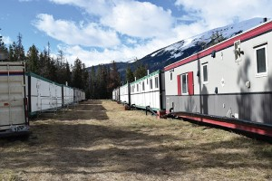 Parks Canada recently set up nine trailers in the old woodlot across from Old Fort Point Road to house its staff this summer. P. Clarke photo.