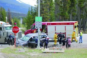 An accident between a tractor trailer and a mini-van temporarily closed a section of Highway 16 on May 12. P. Clarke photo.